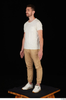 Trent brown trousers casual dressed standing white sneakers white t shirt whole body 0010.jpg